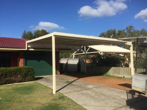 Raised Flat Roof Carport Attached